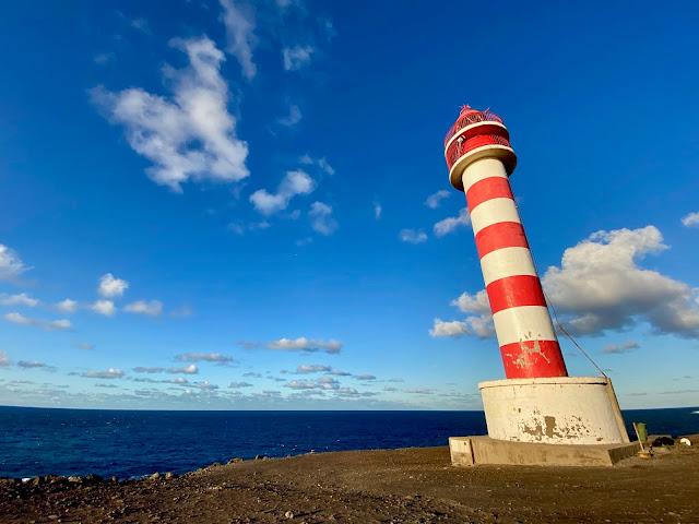 Red and white lighthouse at dusk near Sardina, Gran Canaria, Spain