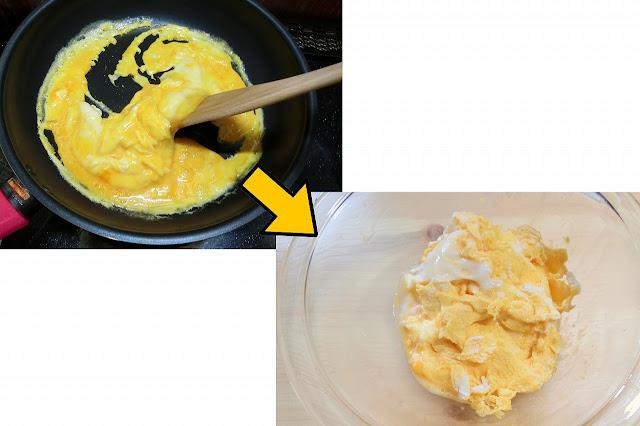 フライパンを熱してごま油を入れ、溶き卵を流し入れて木べらで大きくかき混ぜて半熟状態の大粒炒り卵を作ったらボウルに戻しておきます。