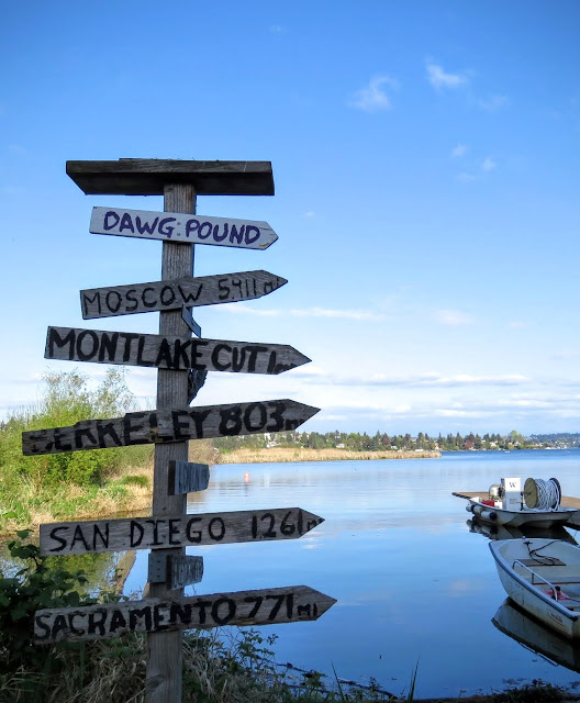 How to Spend a Perfect Sunday in Seattle - wooden arrows pointing to places at Union Bay Natural Area