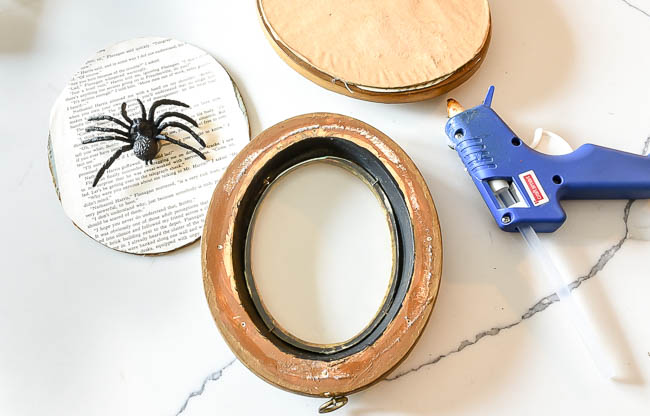 Gluing creepy spiders to vintage book pages