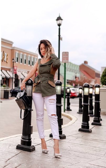 Army green top paired with a white skinny jeans