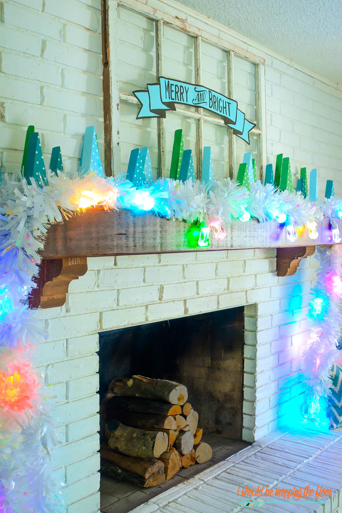 This Christmas Mantel Decor is full of bright lights and fun details!