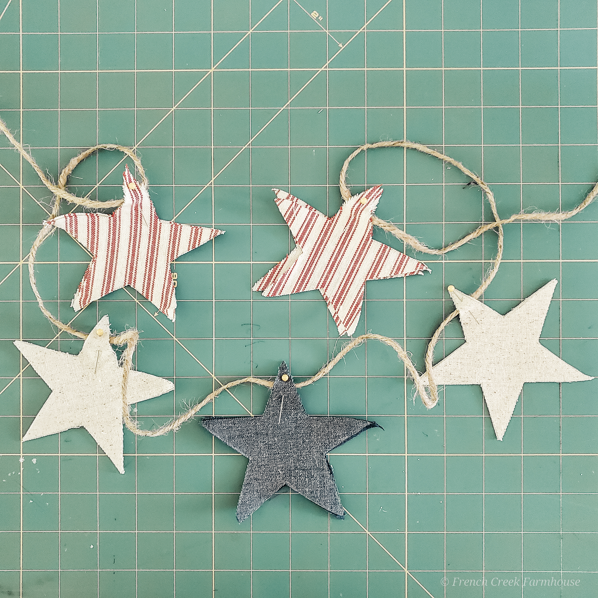 Step Four: Pin stars to twine