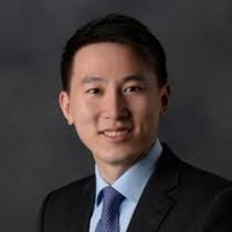Photo of Zhou Shouzi  CFO, Senior Vice President, Executive Director