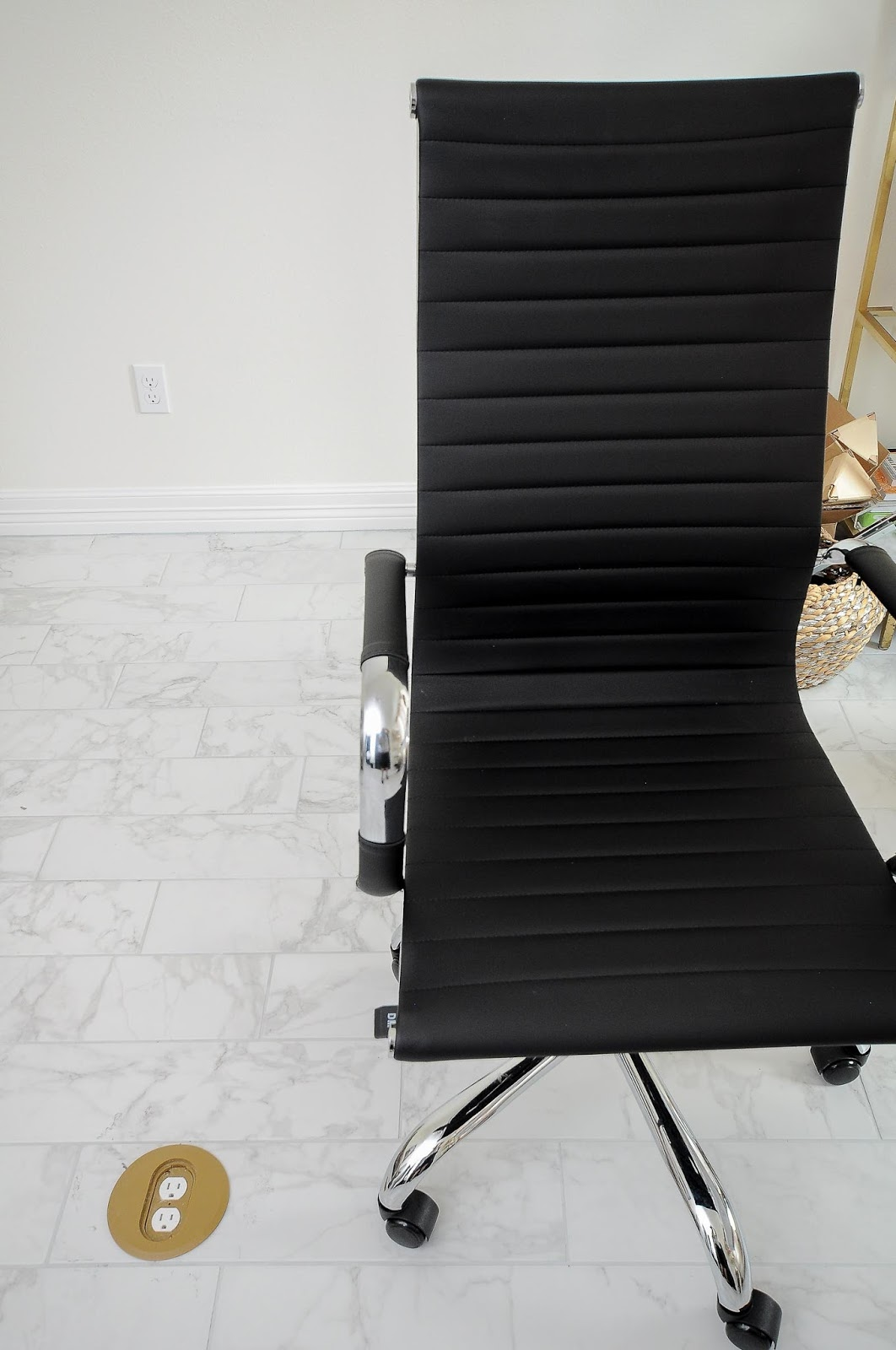 Serge black and chrome high back office rolling chair.