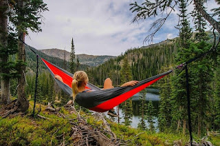 woman in hammock overlooking mountain view