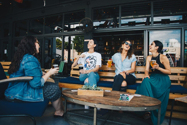 Four women having a drink at a bar