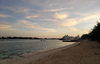 sunset clouds over cruise ships in port