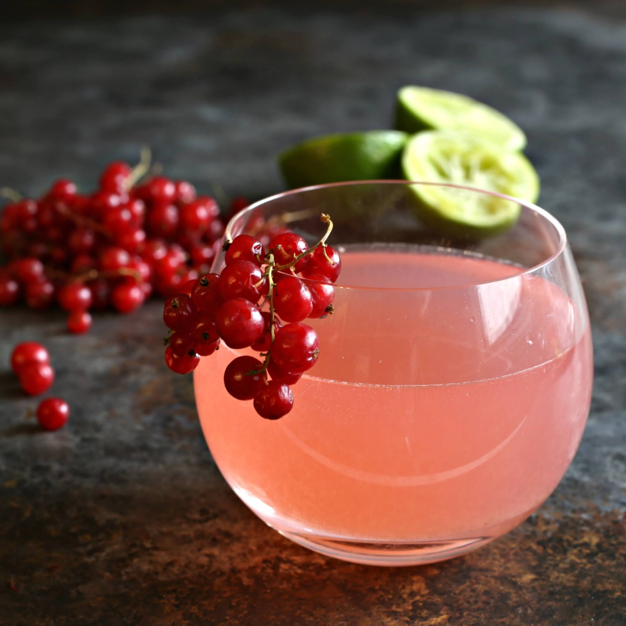 Recipe for a vodka cocktail flavored with red currant syrup, lime and orange liqueur.