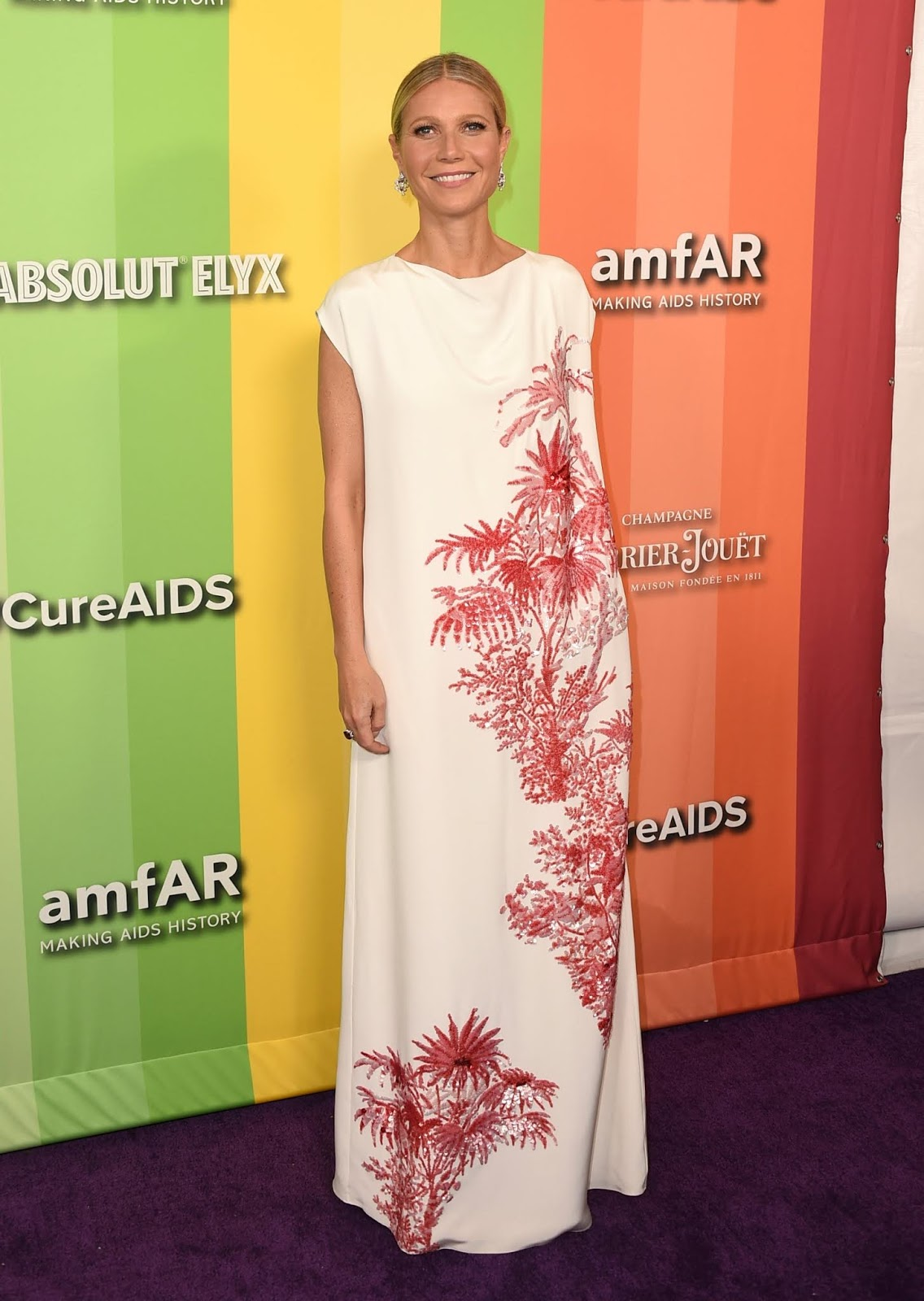 Gwyneth Paltrow showcases draped dress at the 10th Annual amfAR Gala in LA