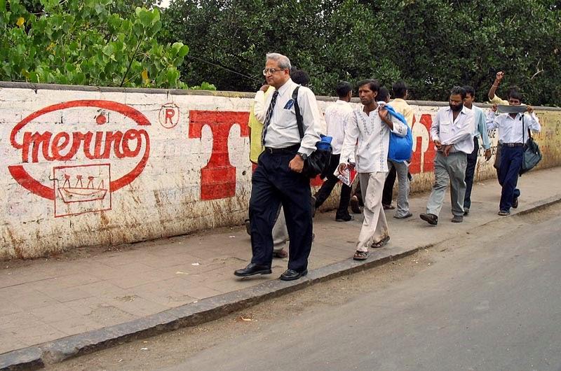 Men walking on the pavement