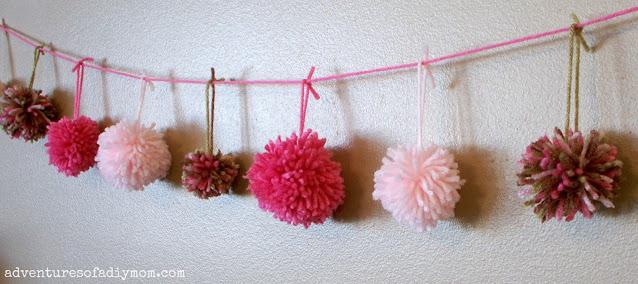 garland of yarn pom poms