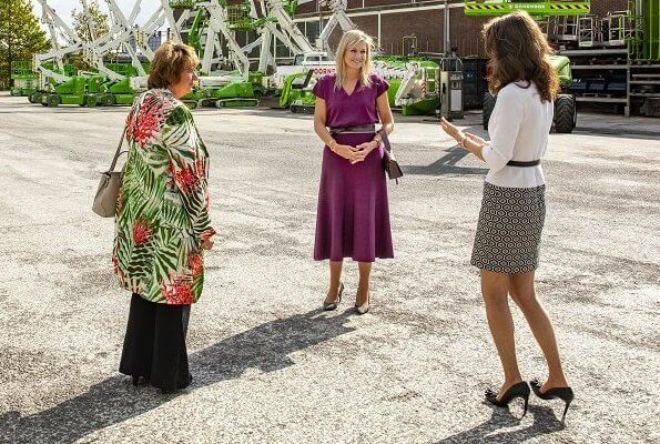 Queen Maxima wore Massimo Dutti total look v-neck sweater and total look flared skirt, Natan pumps, Wandler Georgia leather shoulder bag