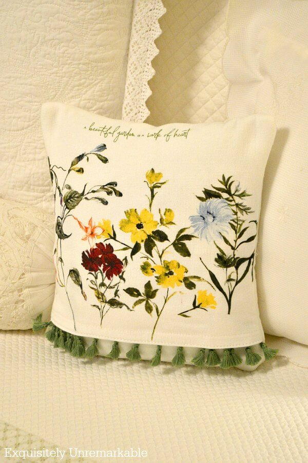 Fringed floral pillow cover made from a dish towel