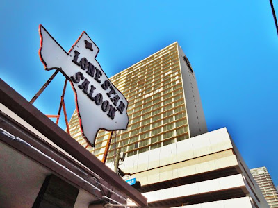 Lone Star Saloon with abandoned Days Inn hotel tower behind roof-top logo