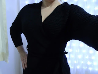 front of black wrapped above knee dress