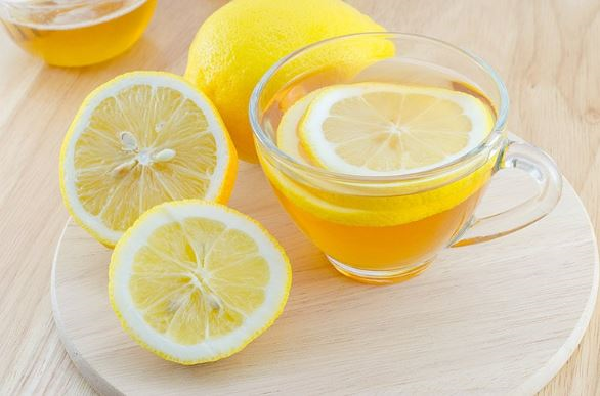 What is the benefit of drinking warm water with lemon on an empty stomach for?