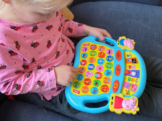 A preschooler learning letter sounds and the alphabet with the Peppa Pig game
