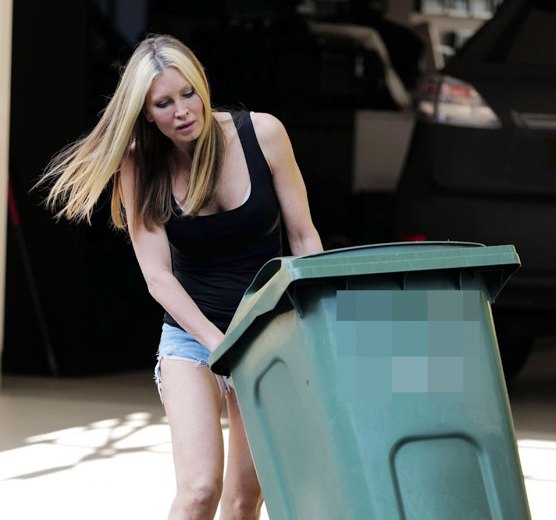 Caprice Bourret Snapped in Denim Shorts Taking Out Trash in London 4 May -2020