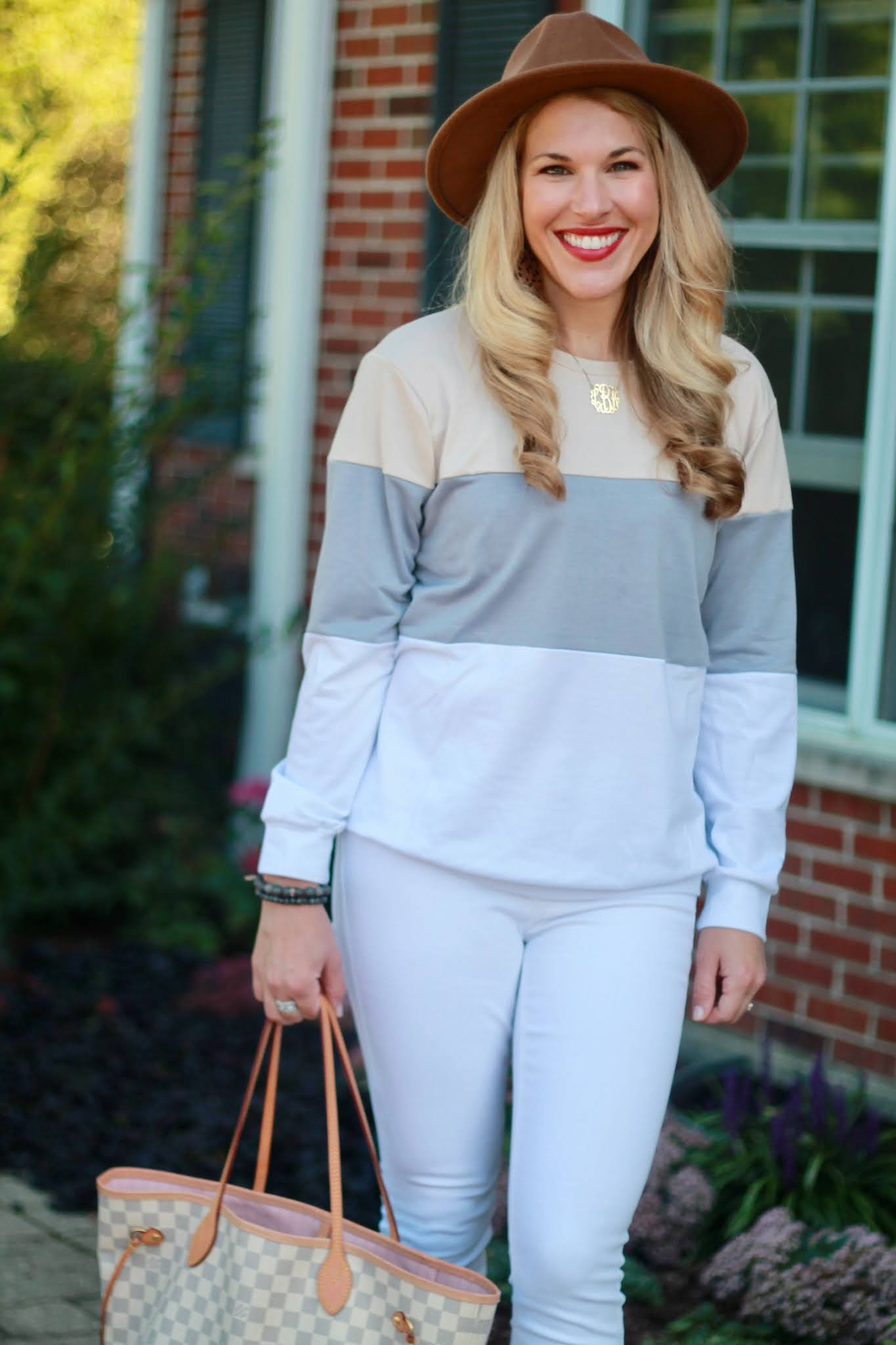 colorblock sweatshirt, white denim, taupe booties, felt camel hat, fall casual look
