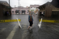 Walking in flooded street (Credit: AP Photo/Stephen B. Morton) Click to Enlarge.