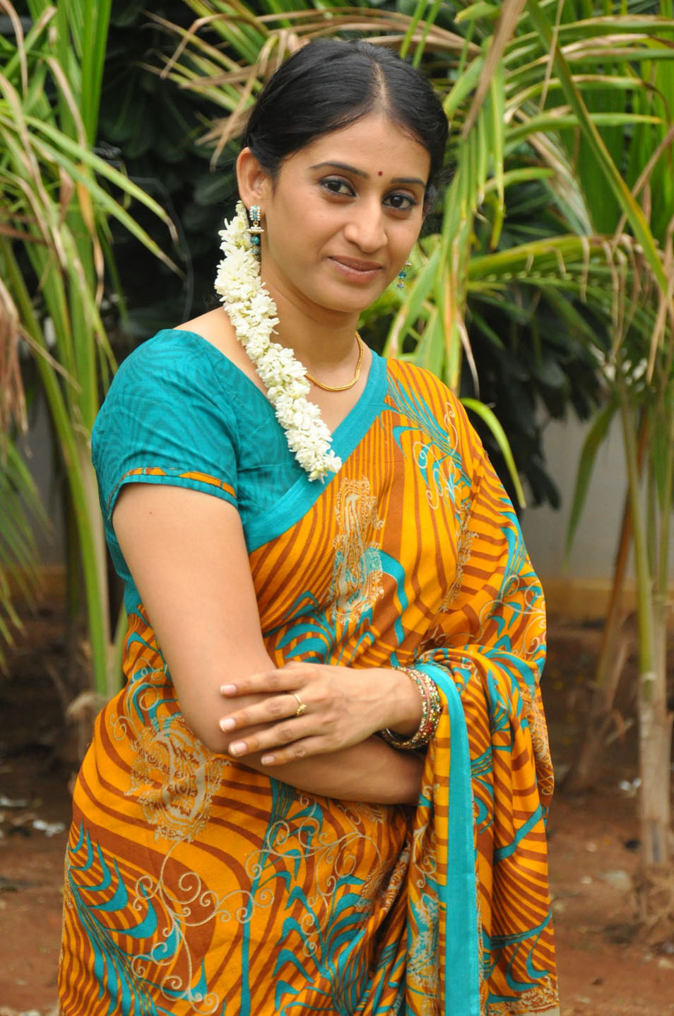 serial telugu actress tv meena kumari saree photoshoot stills latest south spicy krishna yellow spice