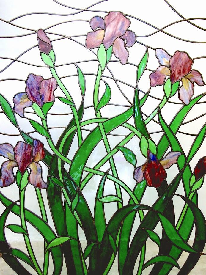 through the round window purple iris stained glass window. Black Bedroom Furniture Sets. Home Design Ideas
