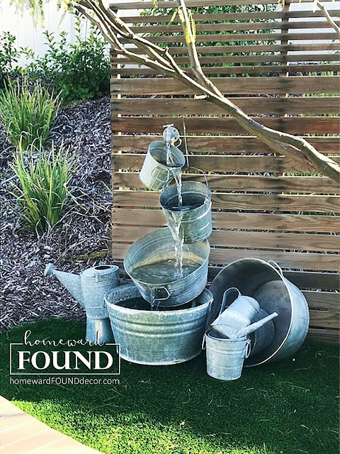 salvaged, junk, junking, diy, garden, backyard decor, home decor, farmhouse style, rustic style, galvanized buckets, fountains, repurposed, diy, spring decorating, industrial style