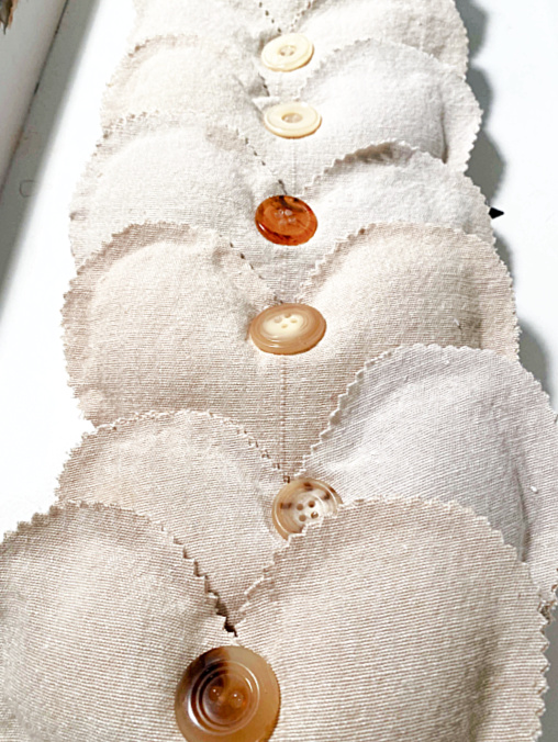 row of muslin hearts with buttons