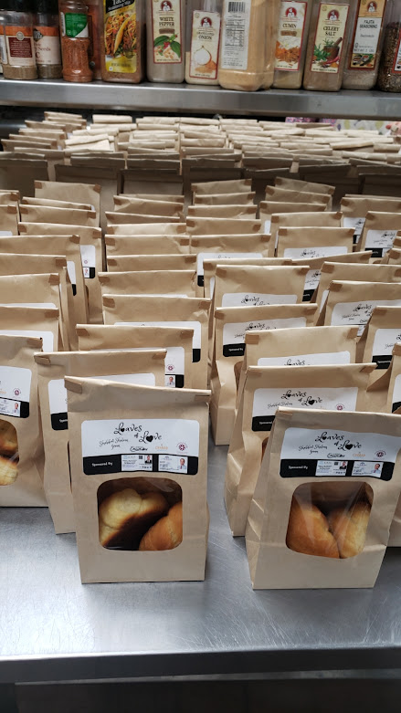 Bags of challah rolls Chabad at La Costa