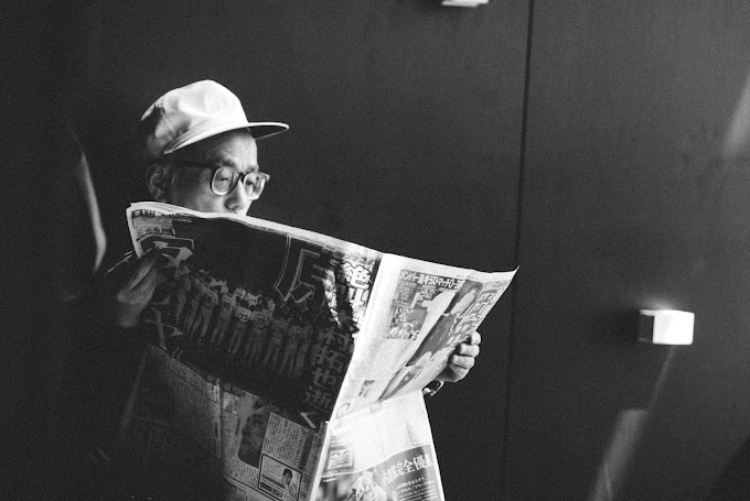 The Man With The Newspaper