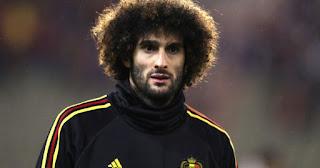 Man United's Marouane Fellaini cuts off all his hair
