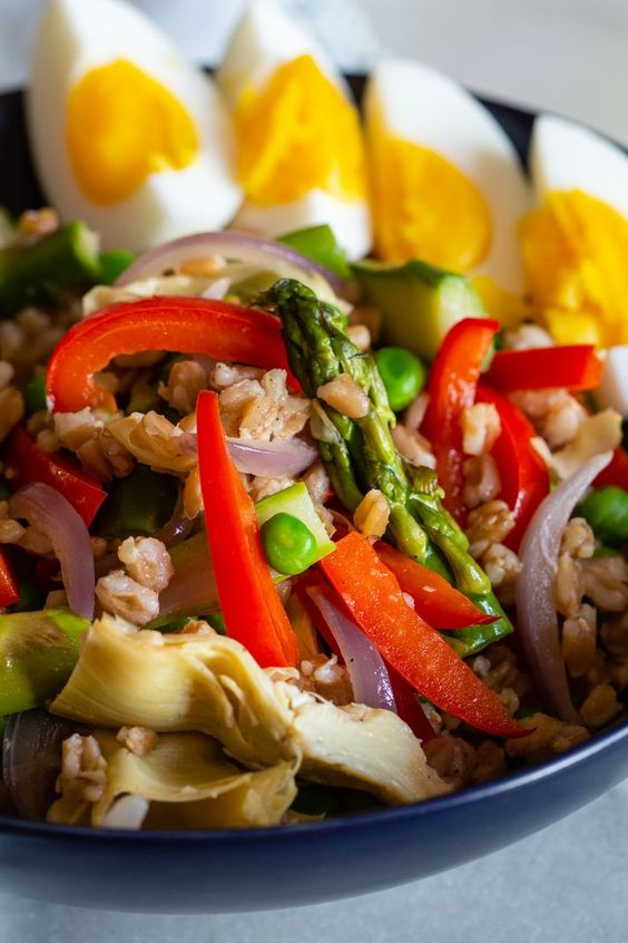 This spring salad with farro, fresh vegetables, and eggs is a protein-packed, meatless lunch or dinner. It's an easy recipe, made partially with help from your Instant Pot!