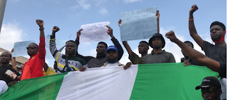 BREAKING: Angry #EndSWAT protesters storm National Assembly in Abuja