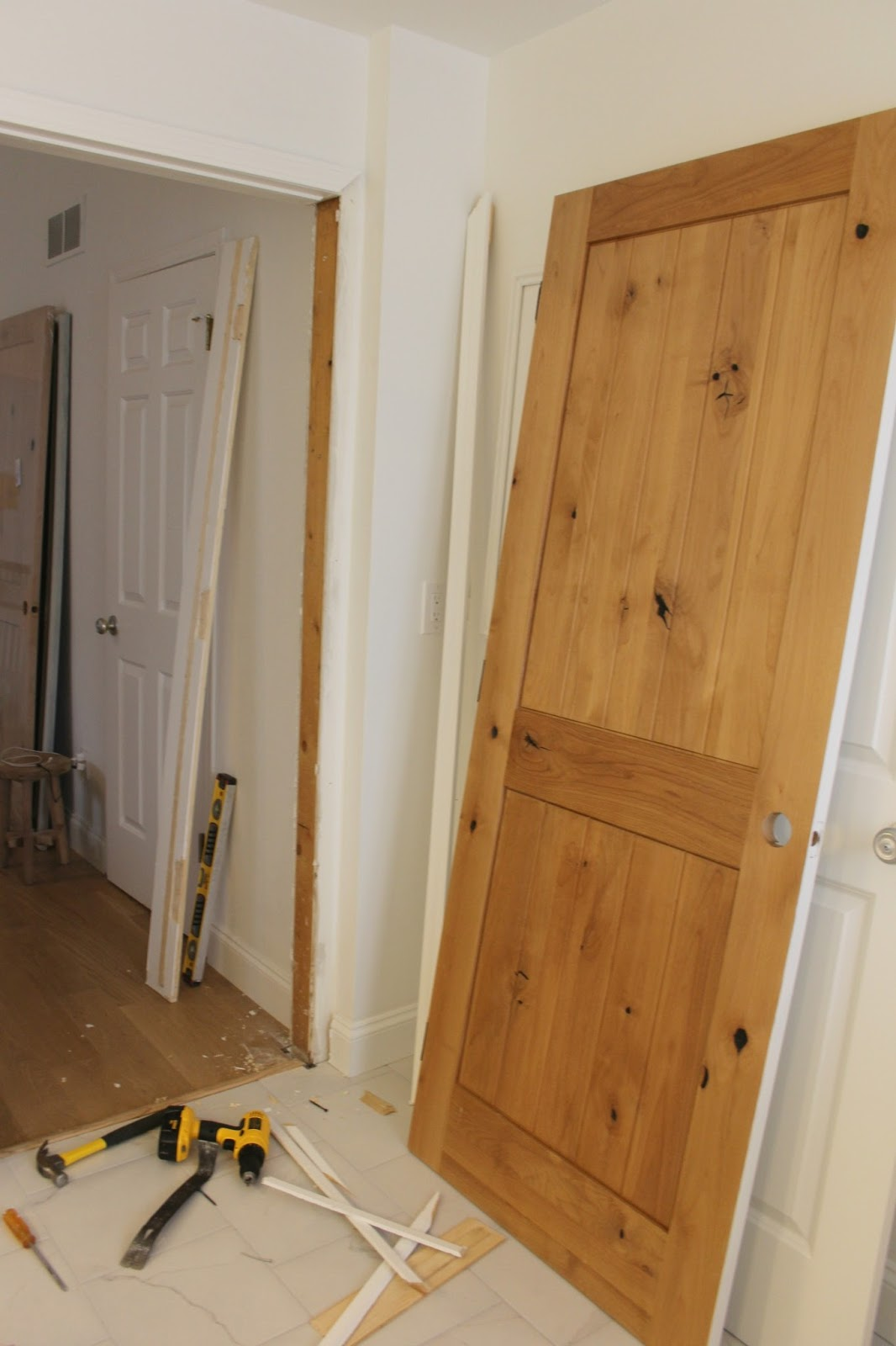 Decor inspiration knotty and nice alder wood hello lovely for Knotty alder wood doors