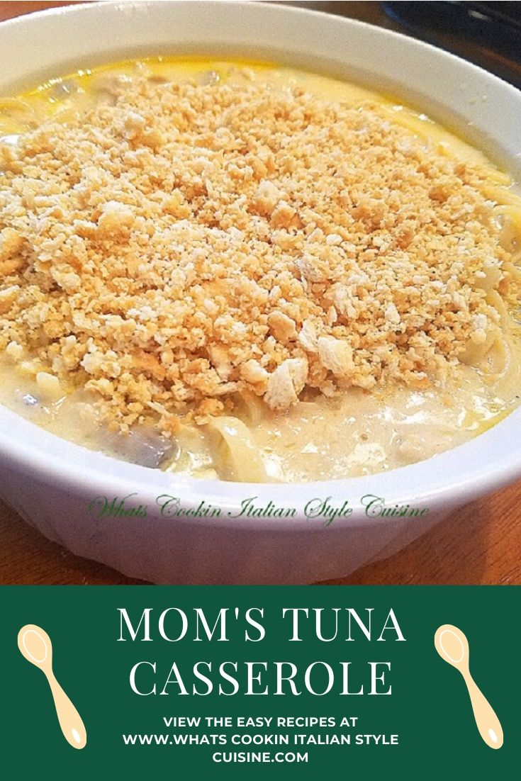 this is a tuna noodle casserole homemade from scratch nothing with soup in it. This casserole with tuna is in a white round baking dish with tuna, noodles and a rich white creamy sauce