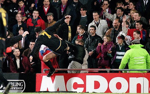 Eric Cantona launches his infamous kung-fu kick on a Crystal Palace fan at Selhurst Park