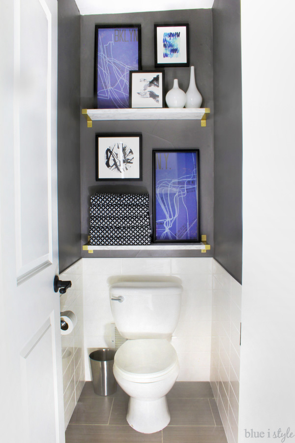 Dark Grey Water Closet with faux marble shelves and art