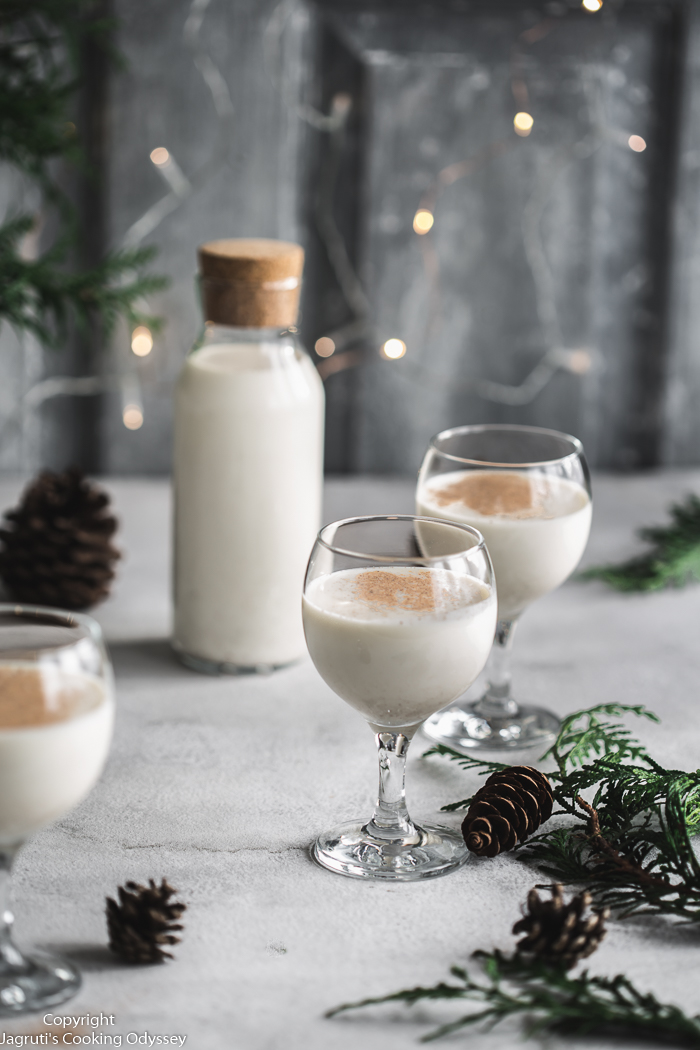 Put on your Christmas jumpers and Santa's hat and celebrate the season with this luxuriously creamy and sweet EGG-FREE NOG that is full of holiday cheer!   This luscious, frothy iconic winter beverage is made from blends of cashews, milk, sugar, cream, and spices totally from scratch!    This A-M-A-Z-I-N-G egg-free eggnog is also non-alcoholic and easily made vegan too. Whether you are a die-hard eggnog fan or newbie have a go at making this recipe and I think you'll be surprised how wonderful homemade Egg-free Nog can be!