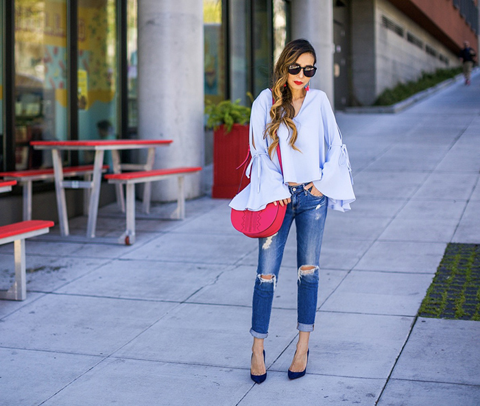 Topshop tie trumpet sleeve top, henri bendel PERFORATED HALF CIRCLE BAG, henri bendel bag, topshop bell sleeve top, baublebar MOSAIC TASSEL DROPS, baublebar earrings, AGjeans, christian louboutin pumps, karen walker sunglasses, san francisco street style, san francisco fashion blog