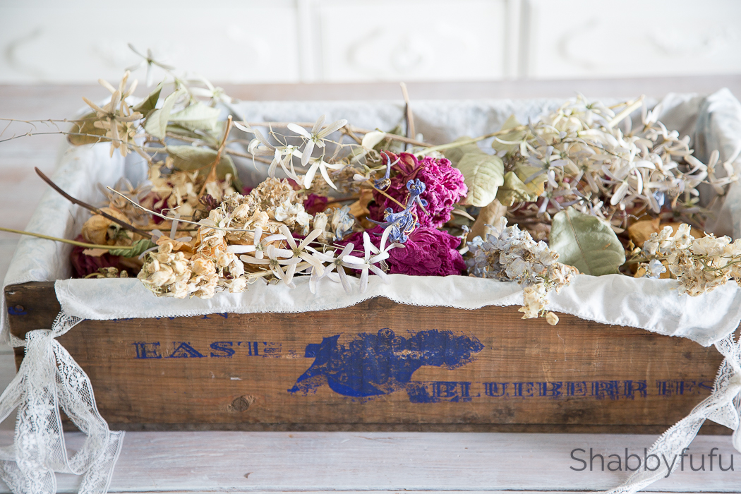 blueberry crate with dried flowers