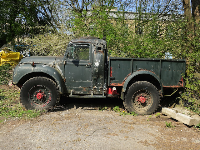 Old and battered green truck. 17th April 2021