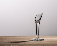 broken wine glass on bare tabletop
