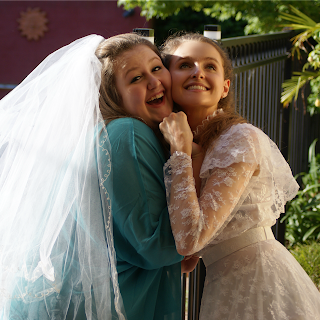 Sisters with Mum's Wedding Dress - Kristy and Katrina