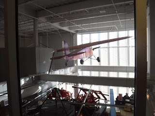 the back of an airplane and other displays in the main floor of the Sioux City Public Museum as seen from the Sioux City Skywalk