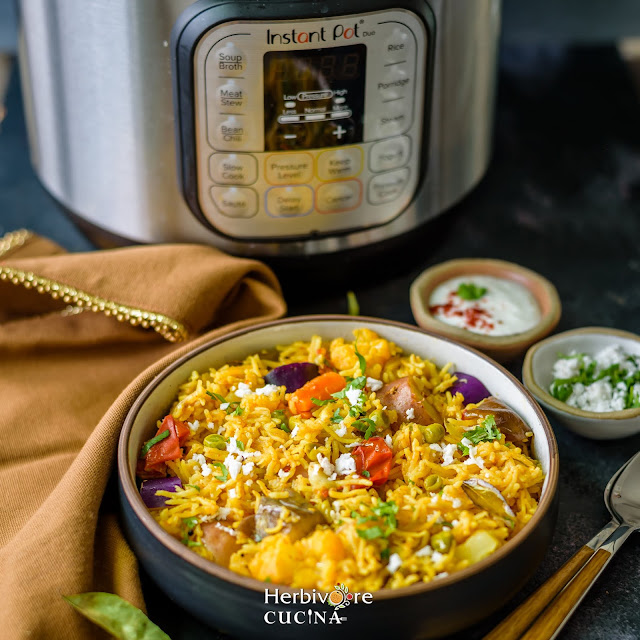 Masale bhaat in bowl with instant pot in background.