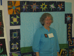 Terry smiles as she creates another story quilt!
