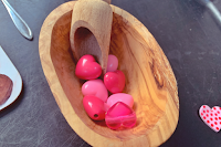 acacia wood dish with pink heart beads