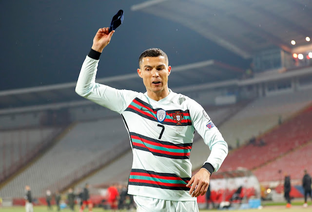 Portugal legend Cristiano Ronaldo throwing his captain armband on the turf during Serbia 2-2 Portugal