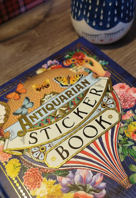 Front cover: The Antiquarian Sticker Book